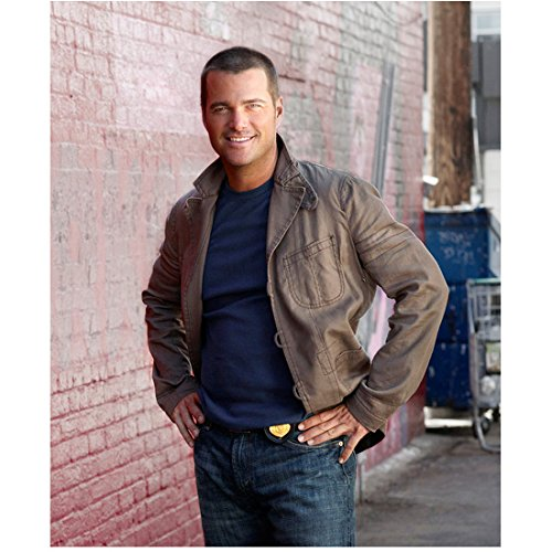 - NCIS: Los Angeles (TV Series 2009 - ) 8 inch x 10 inch Photo Chris O'Donnell Brown Jacket Over Blue Tee Shirt Smiling Hands on Hips kn