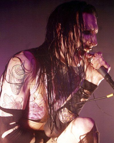 Marilyn Manson kneeling down bare chested in concert singing on stage 8x10 Promotional Photo
