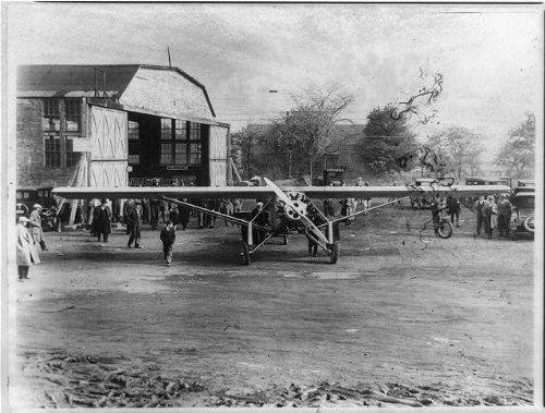 - Photo: Charles Lindberg's plane,the Spirit of St. Louis,1927,hangar,automobiles