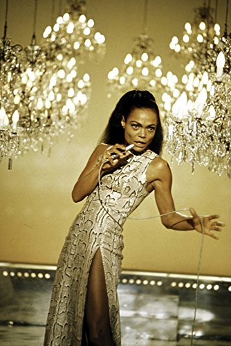 Eartha Kitt singing with chandeliers in the background Photo Print (8 x 10) from Posterazzi