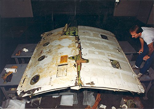 Home Comforts LAMINATED POSTER Date UnknownThe cargo door from United Airlines Flight 811 is assembled after being recovered fro - United Airlines Cargo