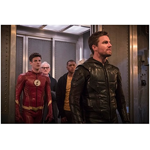 Stephen Amell 8 inch x 10 inch Photograph Arrow (TV Series 2012 -) Getting Off Elevator Followed by Grant Gustin et al kn