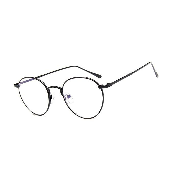 5efa022e7ea54 vintage redondas Transparentes gafas Nerd retro para mujeres Unisexo  montura de metal gafas  Amazon.es  Ropa y accesorios