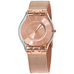 Translucent plastic case with a rose gold-tone stainless steel mesh bracelet. Fixed translucent plastic bezel. Rose dial with white hands and index hour markers. Dial Type: Analog. Quartz movement. Scratch resistant mineral crystal. Pull / pu...