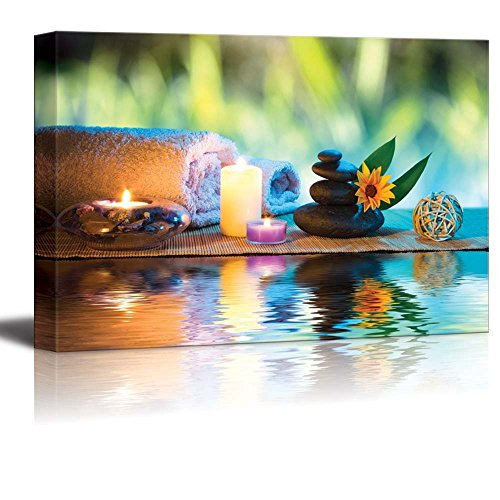 Three Candles and Towels with Black Zen Stones and Orange Daisy on Water Spa Wellness Beauty Concept Wall Decor