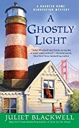 A Ghostly Light by Juliet Blackwell cozy paranormal mystery reviews