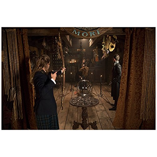 (Once Upon a Time Tiera Skovbye as Robin taking aim at Emma Booth as Gothel 8 x 10 Inch Photo)