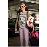 Young Adult (2011) 8 inch by 10 inch PHOTOGRAPH Charlize Theron from Ankles Up Carrying Little White Dog in Bag kn