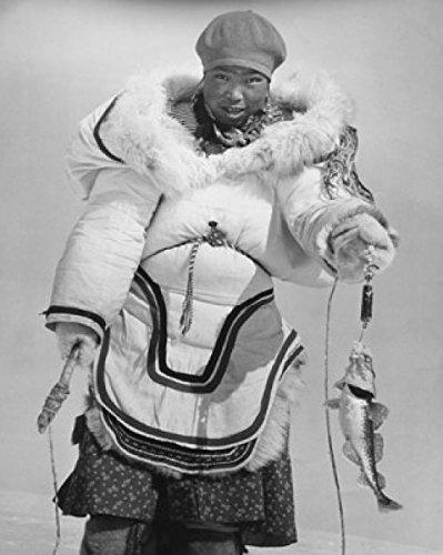 Posterazzi Mid adult Eskimo woman holding a fish Poster Print (24 x 36)]()