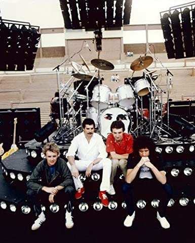 Queen the band sitting on stage in front of drum kit 1970s 11x14 hd