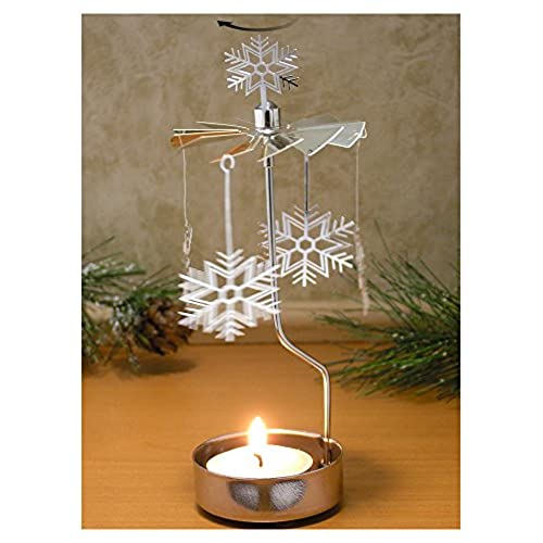 spinning snowflake candle holder silver laser cut snowflake charms turn around when the candle is lit scandinavian design candle holder