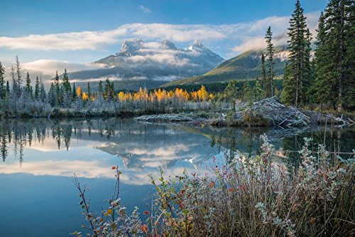 Lake with mountains in background Beaverlodge Three Sisters Canmore Alberta Canada Poster Print by Panoramic Images (24 x 18)