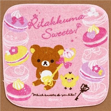 Toalla rosa osito Rilakkuma y pastelitos franceses de Japón