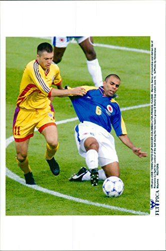 Cup Adrian (Vintage photo of Football World Cup in France 1998. Marizio Serna and Adrian Ilie)