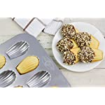 USA Pan Bakeware Madeleine, Warp Resistant Nonstick Baking Pan, Made in The USA from Aluminized Steel, 16-Well, Silver 9 Perfect for delicious French madeleines that bake evenly and taste great; heavy gauge aluminized steel that is commercial grade USA Pan baking pans feature Americoat which promotes quick release of baked-goods plus fast and easy clean up; wash with hot water, mild soap and gentle scrub brush or sponge Nonstick Americoat coating - a patented silicone coating which is PTFE, PFOA and BPA free - provides quick and easy release of all baked-goods and minimal easy clean up
