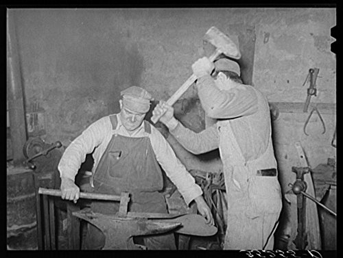 1940 Photo Blacksmith and helper pounding out plow point. Depew, Oklahoma Location: Creek County, Depew, ()