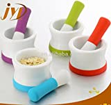 Mortar and Pestle in Ceramic with Soft Silicon Handle and Non-Slip Base. Porcelain material is Dishwasher safe. Choice of 4 Colors.