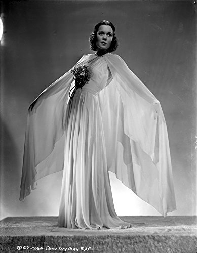 (Posterazzi Jane Wyman Posed in White V-Neck Gathered Bodice and Pleated Skirt with Long Sheer Silk Muffler Photo Poster Print (24 x 30))