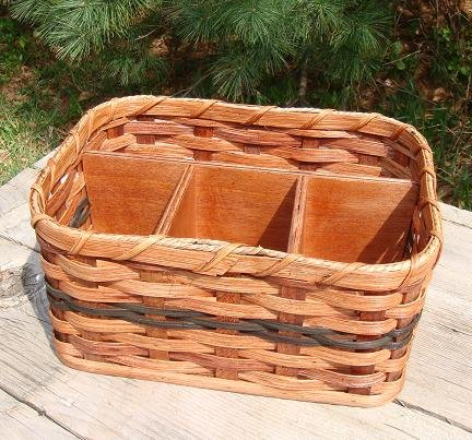 Basket - Napkin and Silverware - Amish Hand Woven Napkin and Silverware Basket Great for Picnics or Organization of Other Items. The Basket Can Be Used to Hold Scissors, Glue, and Other Scrapbooking Items. The Solid Wood Base Size Is 7 1/2 X 11 Inches. The Reed Basket Is 5 Inches Tall. The Three Square Compartments Are About 3 3/16 Inches Square. The Single Long Compartment Is About 11 X 3 3/4 Inches. Accent Colors May Vary (Blue, Green, Red, Burgundy, Purple, Brown, Black, or Natural).