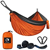 """""""Why choose Canway hammock Compare with other's hammock? Comfortable And Support 500 pounds: This double hammocks fit 2 people comfortably, Lay down with your friend or loved one and still have plenty of room. Because of new 210T nylon, the backpacki..."""