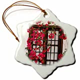 3dRose Danita Delimont - Flowers - Spain, Andalusia. Cordoba. Red bougainvillea and house window. - 3 inch Snowflake Porcelain Ornament (orn_277893_1)