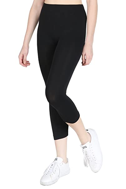 a62025fbbee55 Nikibiki Women's Seamless Basic Capri Legging Tights, Made in U.S.A, One  Size (Black