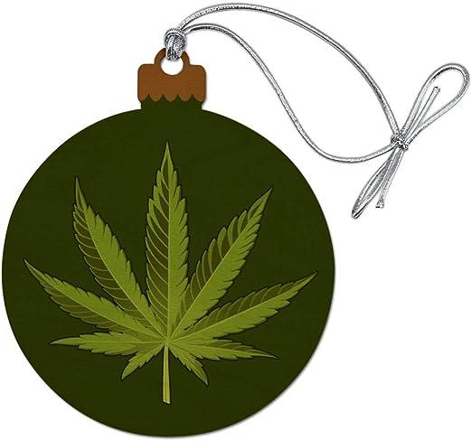 amazon com graphics more marijuana leaf design cannabis pot wood christmas tree holiday ornament home kitchen graphics more marijuana leaf design cannabis pot wood christmas tree holiday ornament