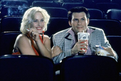 (Patricia Arquette and Christian Slater in True Romance eating popcorn in movie theatre 24x36 Poster)