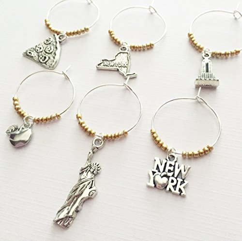 New York Wine Charms, New York City themed wine charm gift. Charms include New York State, New York signage, Apple, Statue of Liberty, Pizza and Empire State Building. Set of 6. GOLD BEADS.
