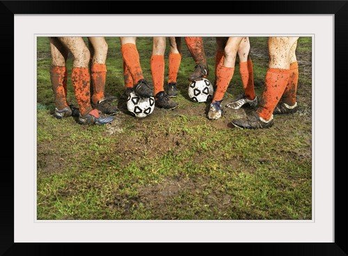 GreatBIGCanvas ''Muddy Legs of Soccer Players '' Photographic Print with black Frame, 30'' X 20'''' by greatBIGcanvas