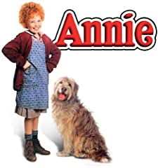 """ANNIE, the story of everyone's favorite plucky, red-haired orphan, finally makes the leap from Broadway to Blu-ray™! One day Annie (Aileen Quinn) is chosen to stay for a week with the famous billionaire """"Daddy"""" Warbucks (Albert Finney). One w..."""