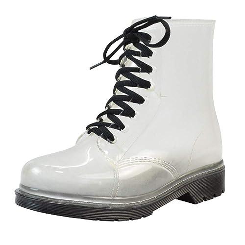 Prácticas botas impermeables transparentes y antideslizantes.