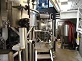 Basic beer brewing equipment. Includes four fermentation tanks, mash tun, and brew kettle.