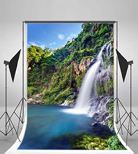OERJU 5x3ft Fabulous Powerful Waterfall Backdrop Blue Skies Clear Blue Water Scattered Rock Photography Background Holiday Boys Girls Adults Artistic Portrait Photo Vlog Video Shooting Props