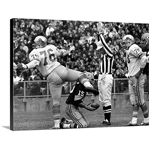 Roger Brown of The Detroit Lions and Quarterback Bart Starr of The Green Bay Packers Canvas Wal.