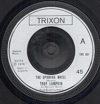 SPINNING WHEEL 7 INCH UK TRIXON 1976: TROY LUMPKIN: Amazon.es: Música