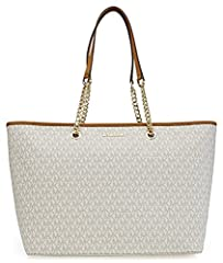 Featuring allover MK print and a spacious, stunning silhouette this MICHAEL Michael Kors Jet Set medium multi function tote is a stylish shopping, girls night out and travel companion.