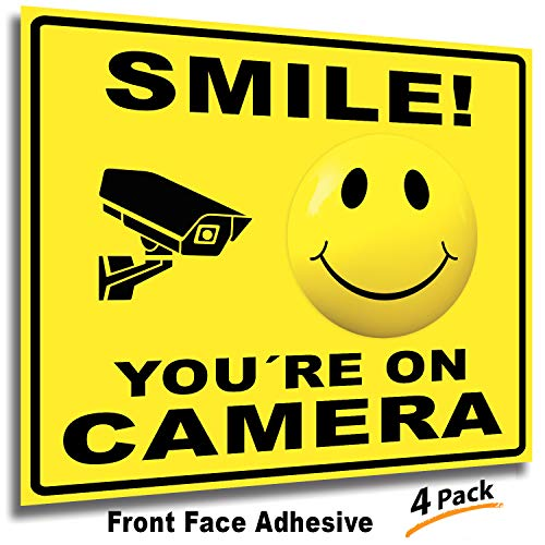 (Smile You're On Camera Signs Stickers - 4 Pack 7x6 Inch - Premium Front Adhesive Vinyl Stickers, UV, Weather, Scratch, Water and Fade Resistance, for applying Inside The Window or Glass Door. )