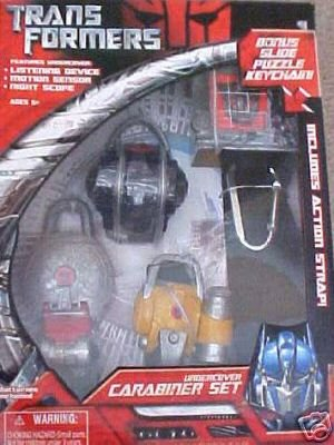 Transformers Undercover Carabiner Set (Listening Device, Motion Sensor, Night Scope) with Bonus Slide Puzzle Keychain and Action Strap! ()