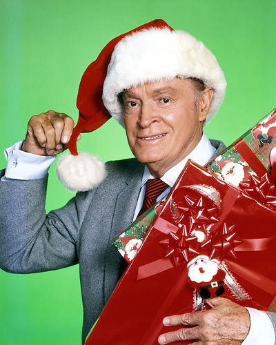 (Bob Hope Santa Claus Hat Holding Presents 8x10 Promotional Photograph)
