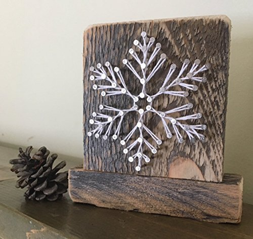 """Sweet and small free standing wooden """"snowy"""" snowflake string art decor. Perfect for holiday home accents, ski cabins and snowflake gifts for winter enthusiasts. from Nail it Art"""