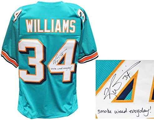 Amazon.com: Dolphins Ricky Williams Signed Teal Jersey w/Smoke ...