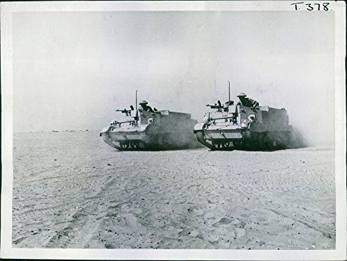 Greek-manned Bren Gun Carriers going into action in the Western Desert. ()