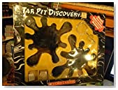 "Tar Pit Discovery Kit includes Booklet, rock samples, magnifying glass and two ""tar"" pits where you will find saber-toothed cat and wooly mammoth skeletons (boxed set)"
