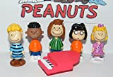 Peanuts Movie Classic Characters Toy Figure Set of 13 with Snoopy, Woodstock, Dog House, Linus, Charlie and More with a Special Decorative Figure! by Peanuts