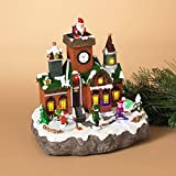 Gerson 10.2 in. Electric Lighted Holiday Village with Moving Santa