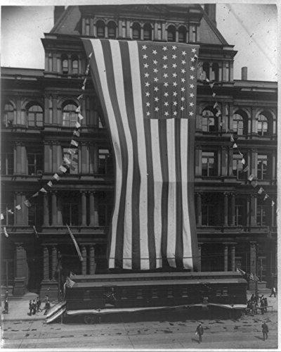 1910 Photo Silver Jubilee celebration, Cincinnati post office an enormous American flag across building facade; a railway post office car parked in front of building. Location: Cincinnati, Ohio
