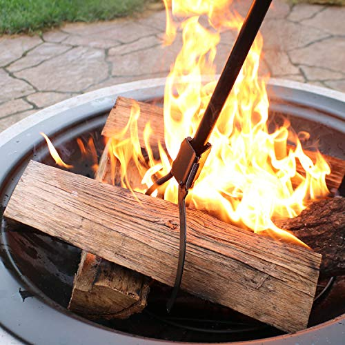 Log claw grabber on open fire pit.