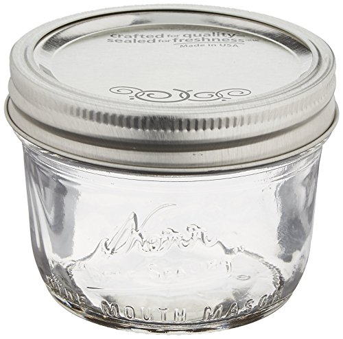 Jarden Kerr Wide Mouth Half-Pint Glass Mason Jars 8-Ounces with Lids and Bands 12-Count per Case (1-Case)]()