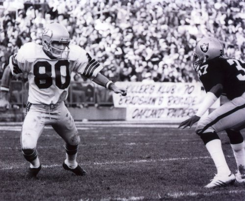 STEVE LARGENT SEATTLE SEAHAWKS & LESTER HAYES OAKLAND RAIDERS 8X10 SPORTS ACTION PHOTO (A)